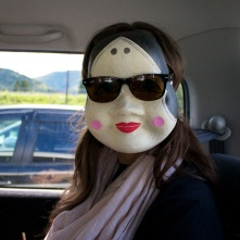 Hiding from the paparazzi. She's huge in Japan.