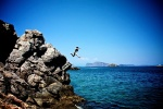 Annie jumping in Hydra, Greece