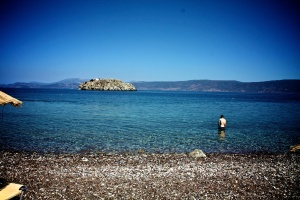 Grayson wading in Hydra, Greece