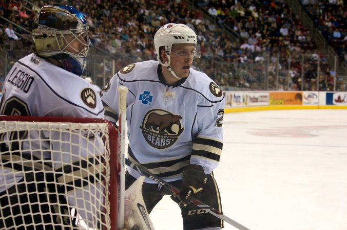 Hershey Bears' Nate Schmidt and Goaltender David Leggio vs Syracuse Crunch 18 December 2013. (Annie Erling Gofus/Olympus Athletics)