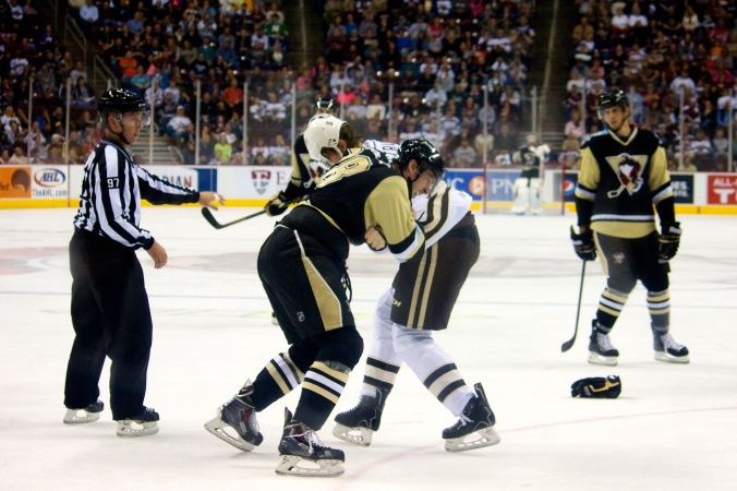 Tyson Strachan of the Hershey Bears fights with a Wilkes-Barre/Scranton Penguins player in Hershey, PA. (Annie Erling Gofus)