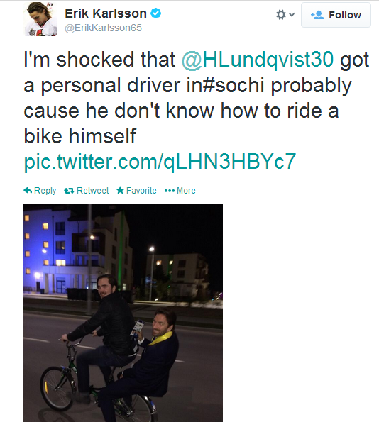 Henrik Lundqvist hitches a ride on the back of a bike in Sochi.