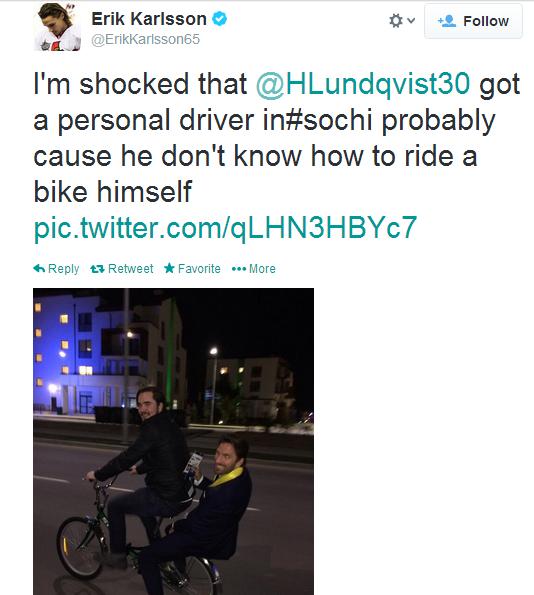 Henrik Lundqvist hitches a ride on the back of a bike in Sochi.